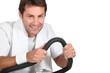 Man using a running machine in a gym