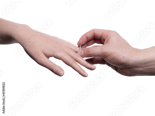 Man put a ring on woman's finger - isolated