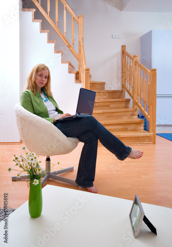 woman with laptop at home