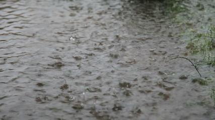Heavy downpours of rain splashing