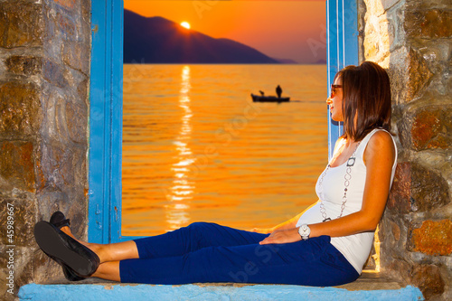 Beautiful woman looking sunset
