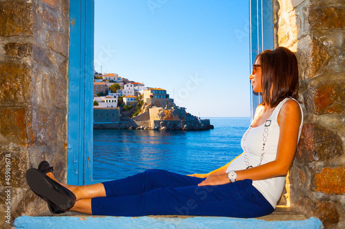 Woman looking view of Hydra Island in Greece.psd