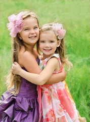Portrait of two embracing cute little girls