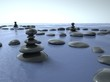 Zen stones in water, blue sky