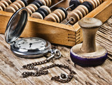 pocket watch, abacus and stamp