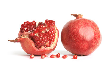 Ripe pomegranates on white background. Punica granatum.
