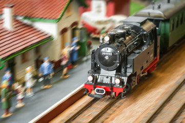 express steam train speeding through a station