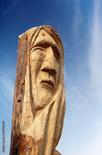 Face Carved on Tree Trunk