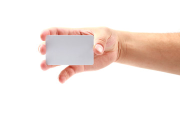 Hand showing credit card or business card. Isolated on white