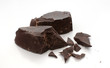 Cut and broken pieces of dark chocolate