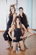 Team of pole fitness instructors smiling