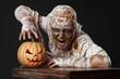 mummy in the studio with pumpkin