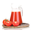 Tomato juice in pitcher on wicker mat isolated on white