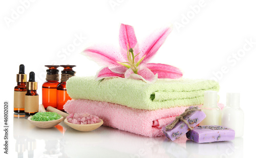 towels with lily, aroma oil, soap and sea salt isolated on