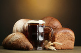 tankard of kvass and rye breads with ears,
