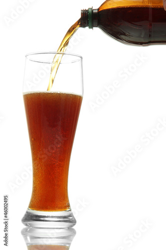 kvass poured into a glass, isolated on white