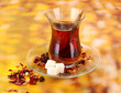 glass of Turkish tea on color background