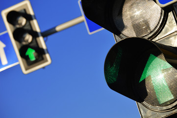 Traffic lights over the blue sky