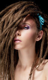 Fototapety Dreadlocks. Fashion hairstyle with dreads - beauty woman face