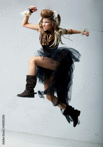 Tribe. Wild tribal person jumping - retro style. Antique
