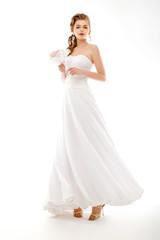 Portrait of beautiful bride. Wedding dress. Bouquet of flowers