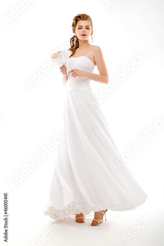 Portrait of beautiful bride. Wedding dress. Bouquet of flowers