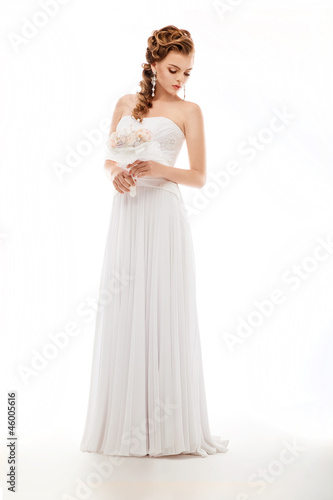 Beauty newlywed woman with wedding bouquet of flowers