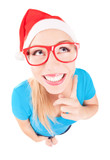 Photo of a funny Santa girl pointing up