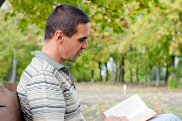 Man enjoying a book outdoors