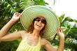 Woman in the tropical garden.