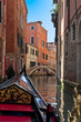 A view from gondola during the ride through the canals of Venice