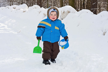 One-year-old boy play in snow