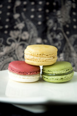 three color macarons on black