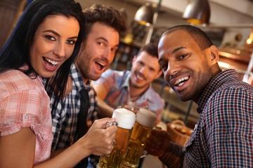 Happy young people having fun in bar
