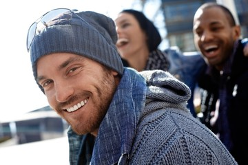 Happy young man in hat and scarf