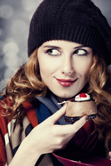 Style girl with cake and bokeh at background.