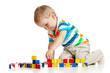 kid boy playing toy blocks  isolated on white background