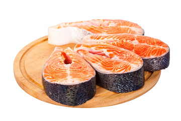 Four raw salmon steaks