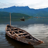 Fototapety Landscape with boat, mountains and clouds Lang Co bay, Vietnam