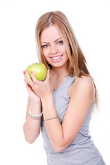 Beautiful and attractive young woman with green apple