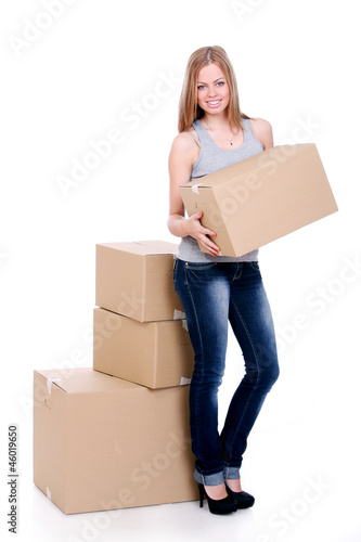 Young and beautiful smiling woman with boxes