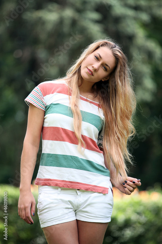 Young and beautiful woman walking in the park