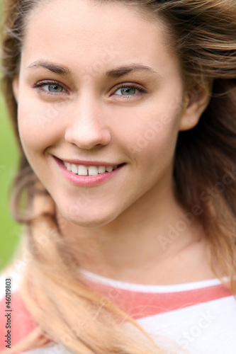 Portrait of beautiful girl with attractive smile