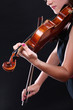 Closeup of young woman with a violin