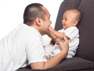 Baby playing with dad