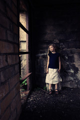 Young girl in grungy building