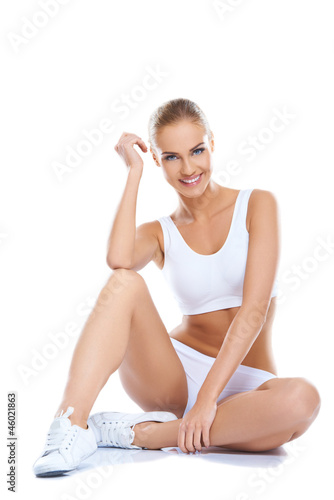 Beautiful woman wearing white underwear sitting