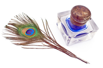Peacock feather quill and inkwell