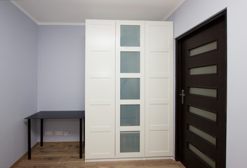 Modern apartment interior with wardrobe