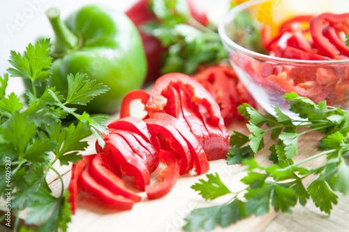 Fresh raw peppers sliced ​​and whole. ripe vegetables